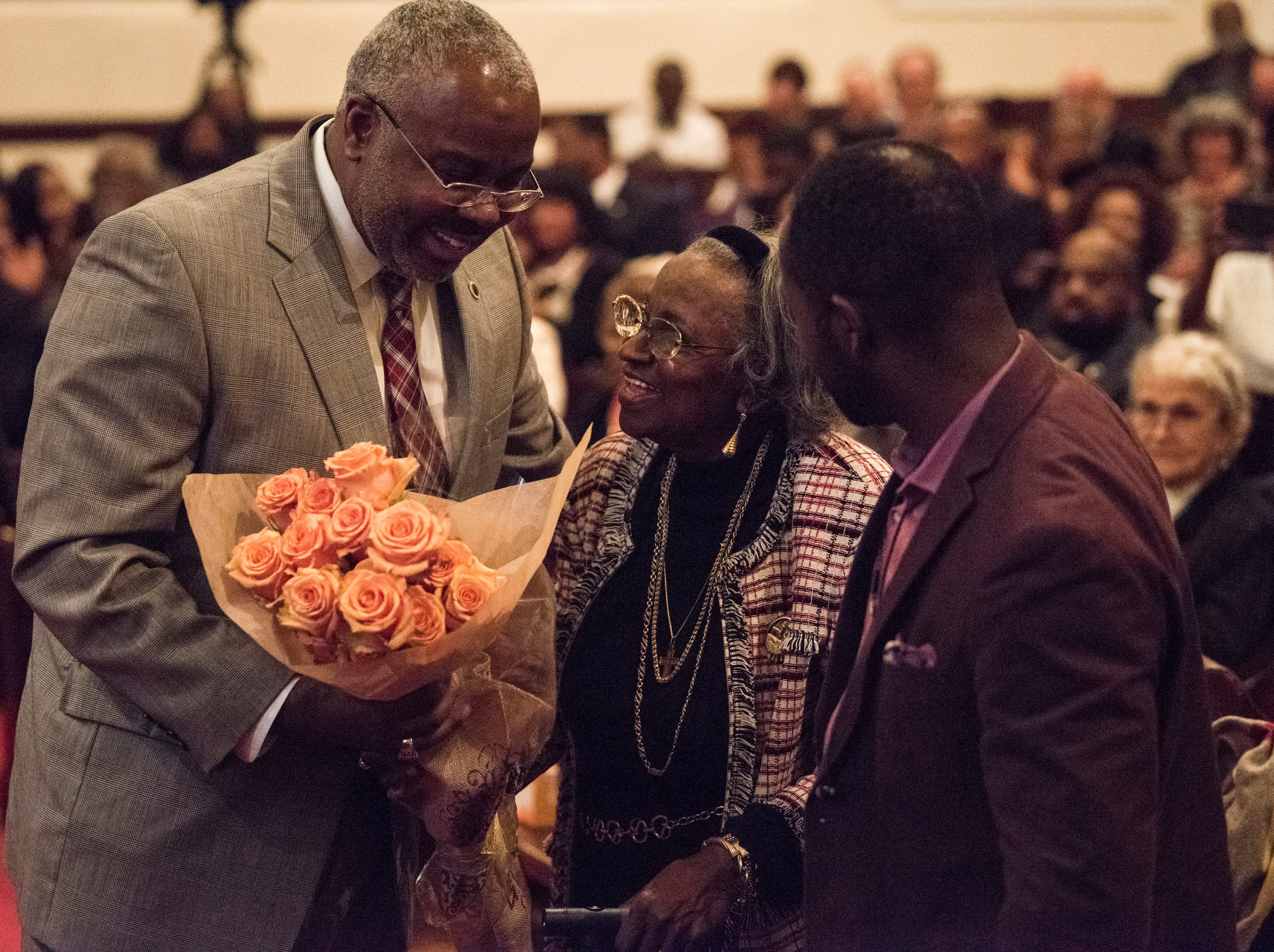 Alabama State University President Quinton Ross honors Juanita Abernathy during 63rd anniversary of the Montgomery bus boycott ceremony at First Baptist Church in Montgomery, Ala., on Monday, Dec. 3, 2018.