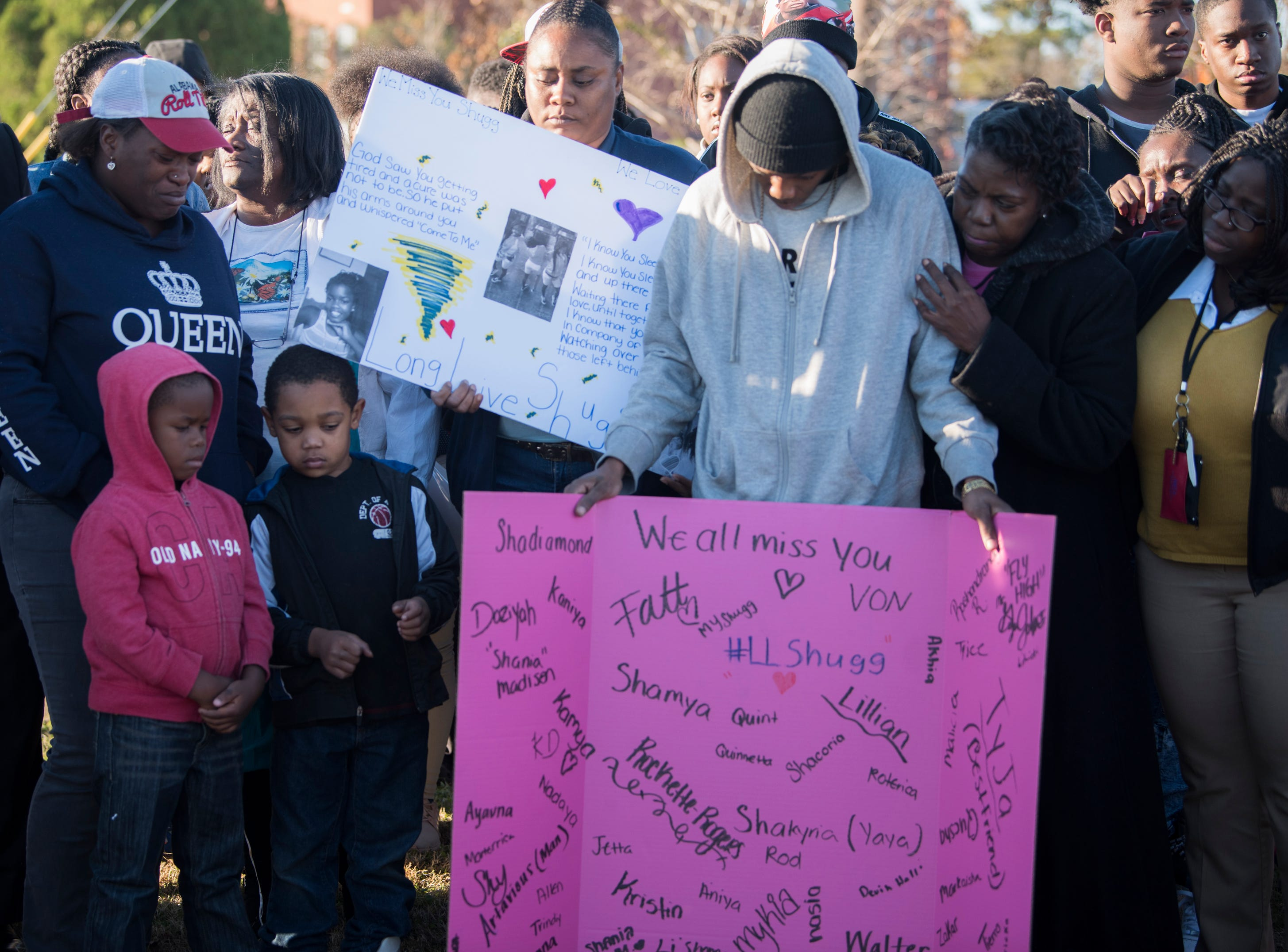 The family receives condolences from friends during a vigil for Keiauna Williams across from Carver High School in Montgomery, Ala., on Tuesday, Dec. 4, 2018. Williams was died after being hit by a car Saturday night.