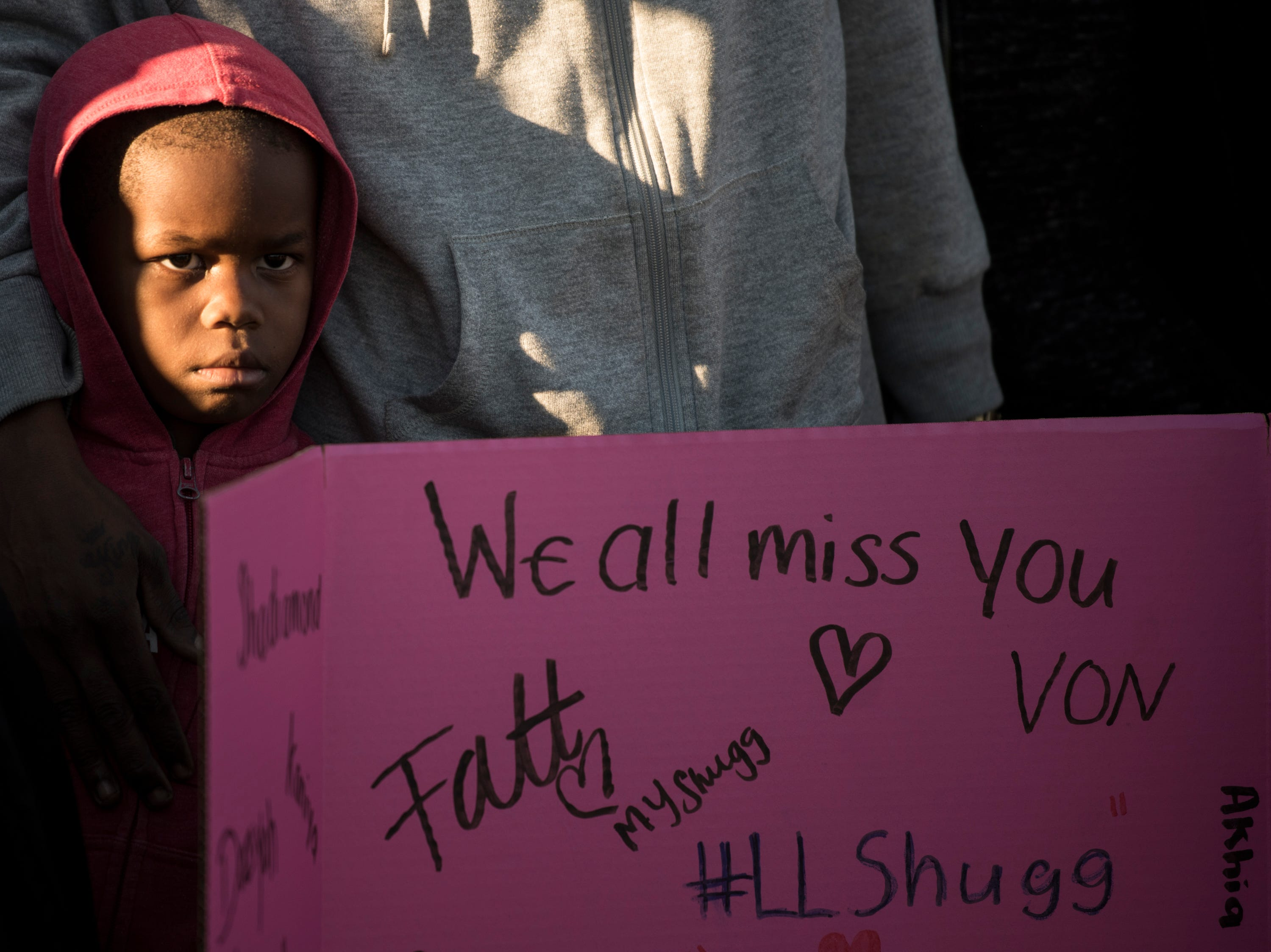 Zailyn Williams, 5, watches on during a vigil for his sister, Keiauna Williams, across from Carver High School in Montgomery, Ala., on Tuesday, Dec. 4, 2018. Williams was died after being hit by a car Saturday night.