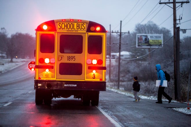 A school bus stops along East Jackson Street  in this file photo.