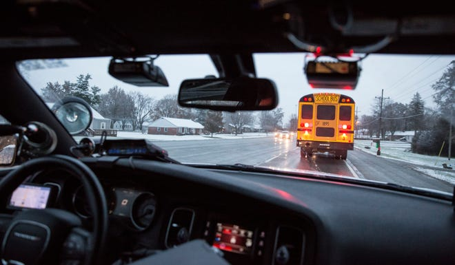 Indiana State Police Master Trooper Kyle West follows school buses in the morning as they travel along East Jackson Street between the Muncie Bypass and Selma Elementary to ticket stop arm violators. West works closely with school bus barns that report they are having problems with drivers bypassing their stop arms.