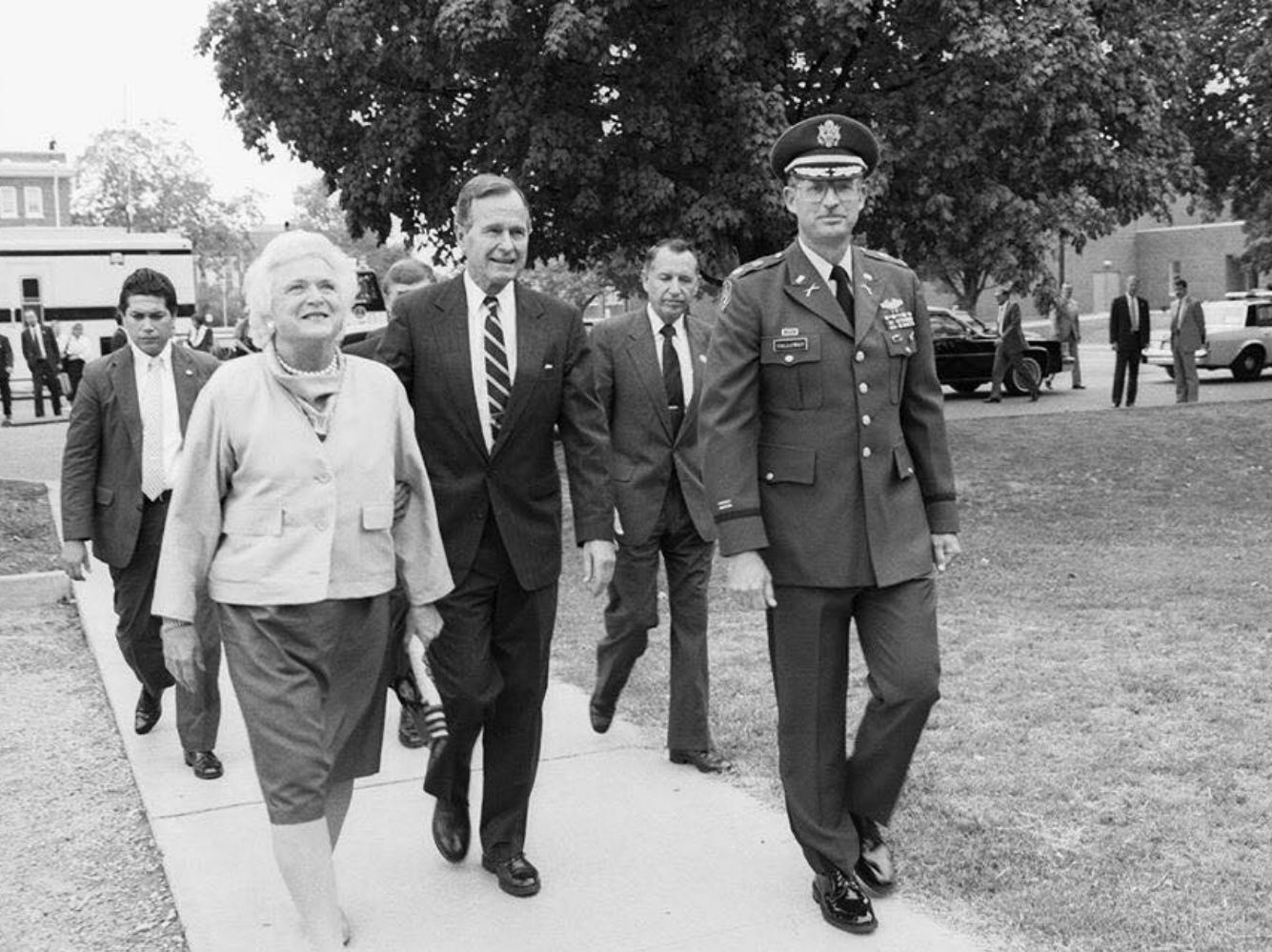 In this Aug. 29, 1988, file photo, Vice President George H.W. Bush, center left, and his wife, Barbara Bush, walk with Lt. Col. Cal Calloway, far right, MTSU Department of Military Science chair, and then-MTSU President Sam Ingram, center right from a parking lot toward the campus ROTC building for a briefing and display. The Bushes were visiting MTSU as part of a fundraising trip to Nashville during the 1988 presidential campaign.