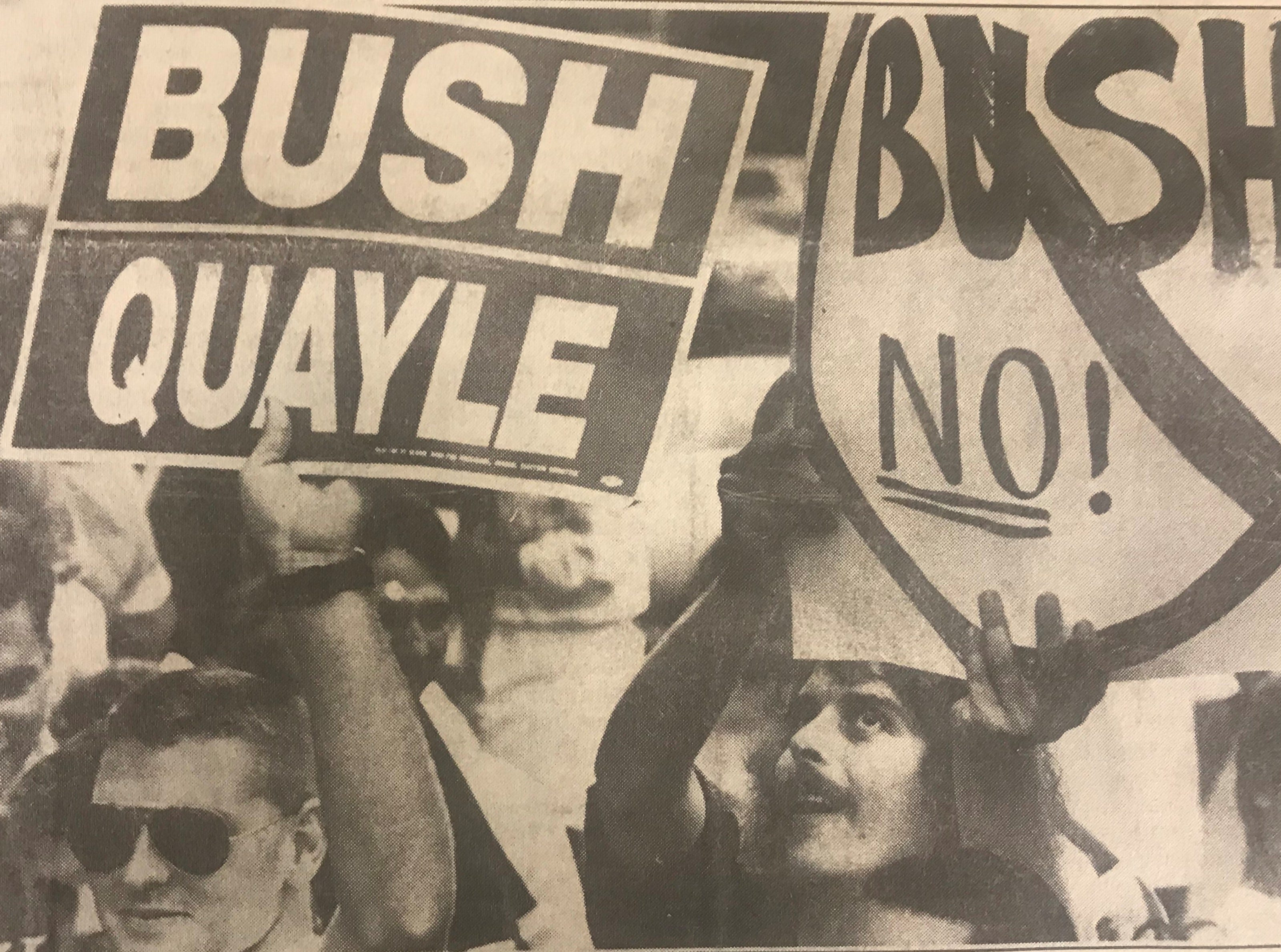 In this Aug. 29, 1988 photo, a protester and supporter stand beside each other at Vice President George H.W. Bush's presidential campaign held at MTSU in Murfreesboro, Tenn.