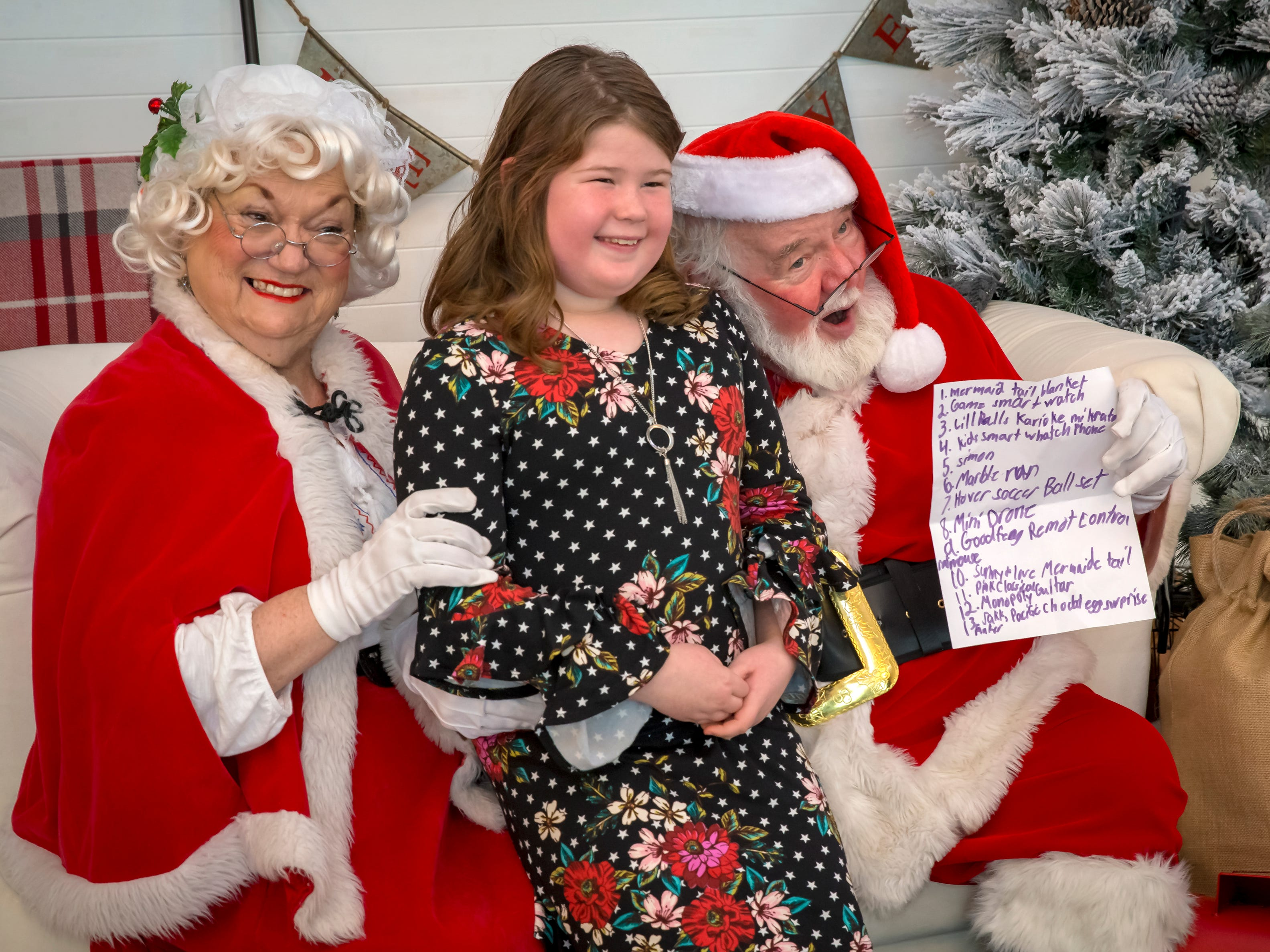Anna Rainwater shared her Christmas list with Santa and Mrs. Claus during a visit to The Fountains at Gateway on Saturday, Dec. 1.