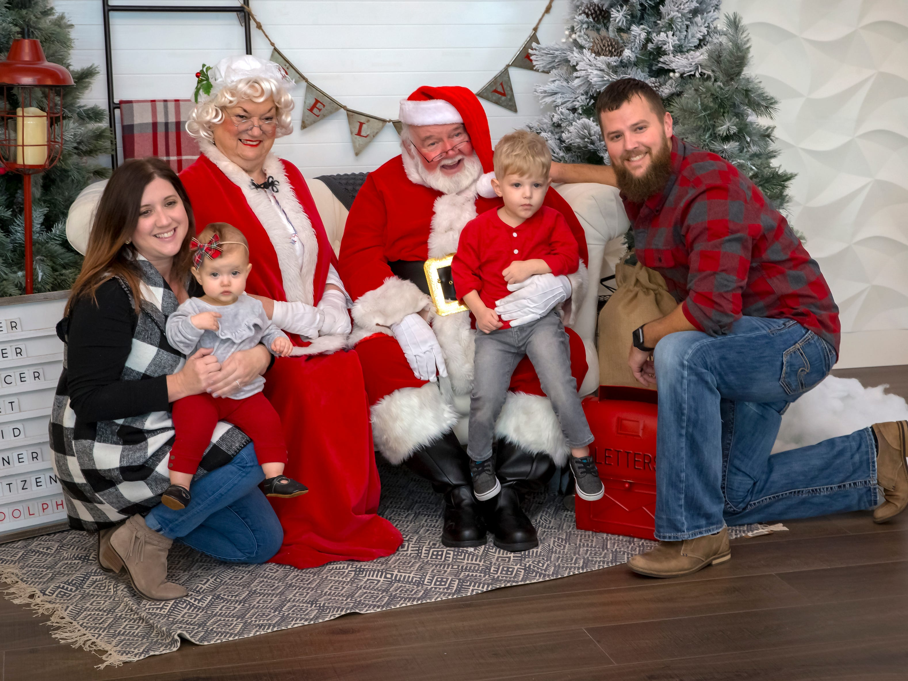 Jack, Leah, Sonya and Chris Turner have their photo taken with Santa during pictures with Santa at Fountains of Gateway.