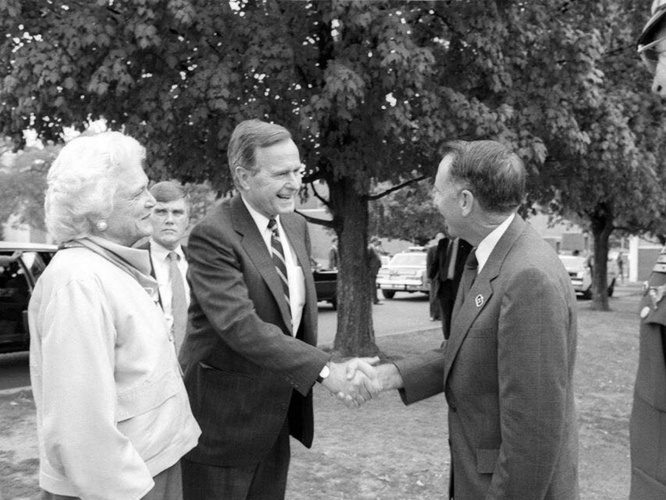 In this Aug. 29, 1988, file photo, Vice President George H.W. Bush, center left, and his wife, Barbara Bush, are welcomed to the Middle Tennessee State University campus by then-president Sam Ingram, center right. At far right is Lt. Col. Cal Calloway, then-chair of the Department of Military Science. The man behind the Bushes is a Secret Service agent. The Bushes were visiting MTSU as part of a fundraising trip to Nashville during the 1988 presidential campaign.