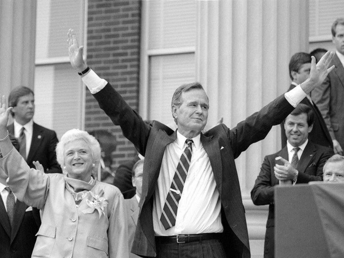 In this Aug. 29, 1988, file photo, Vice President George H.W. Bush, center, and his wife, Barbara Bush, wave to the crowd after his campaign speech at Kirksey Old Main on the campus of Middle Tennessee State University. The Bushes were visiting MTSU as part of a fundraising trip to Nashville during the 1988 presidential campaign.