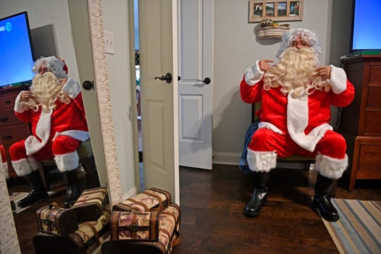 Sid Heffington fluffs his beard Monday, Dec. 3, 2018, in Thompson's Station. Heffington is dressing up as Santa and going to homes for kids with sensory issues or special needs.