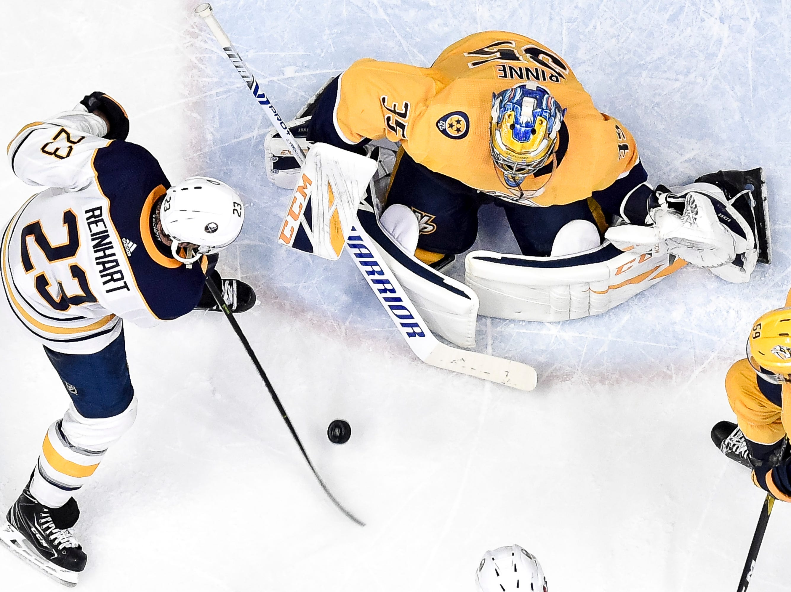 Nashville Predators goaltender Pekka Rinne (35) defends against Buffalo Sabres center Sam Reinhart (23) during the third period at Bridgestone Arena in Nashville, Tenn., Monday, Dec. 3, 2018.