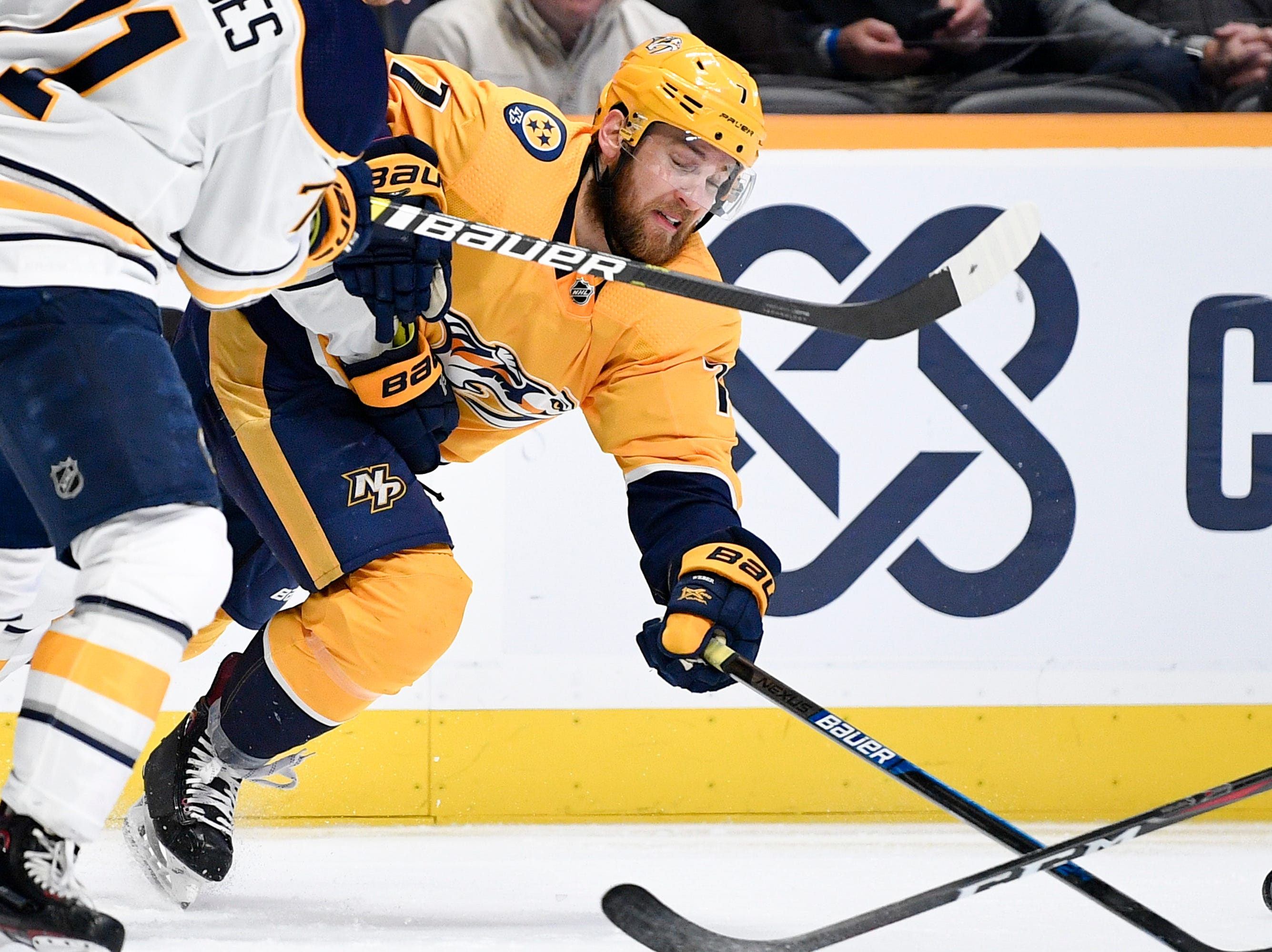 Nashville Predators defenseman Yannick Weber (7) chases the puck against the Buffalo Sabres during the third period at Bridgestone Arena in Nashville, Tenn., Monday, Dec. 3, 2018.