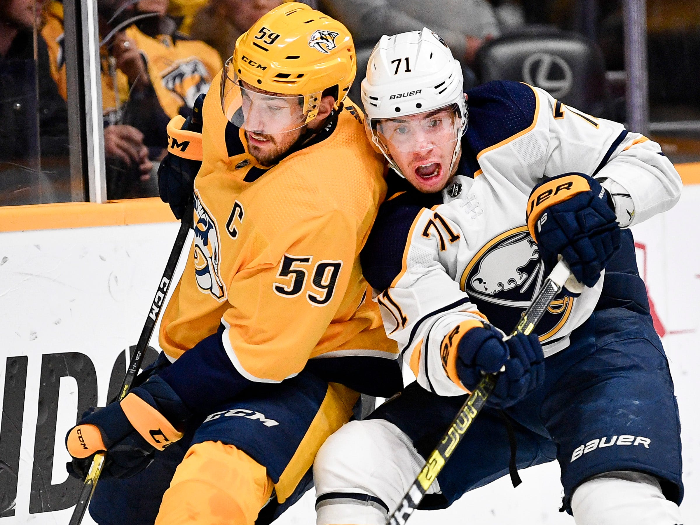 Nashville Predators defenseman Roman Josi (59) battles Buffalo Sabres right wing Tage Thompson (72) during the second period at Bridgestone Arena in Nashville, Tenn., Monday, Dec. 3, 2018.