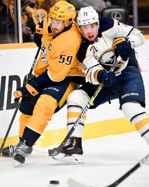 Predators defenseman Roman Josi battles Sabres right wing Tage Thompson on Dec. 3. Josi is the Preds' leader in shots on goal with 130 this season, good for sixth in the league.
