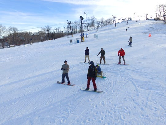 A snowboarding lesson at Hidden Valley Ski Resort.