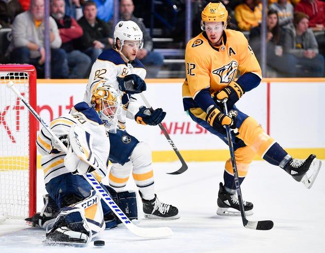 Buffalo Sabres goaltender Carter Hutton (40) defends against Nashville Predators center Ryan Johansen (92) during the first period at Bridgestone Arena in Nashville, Tenn., Monday, Dec. 3, 2018.