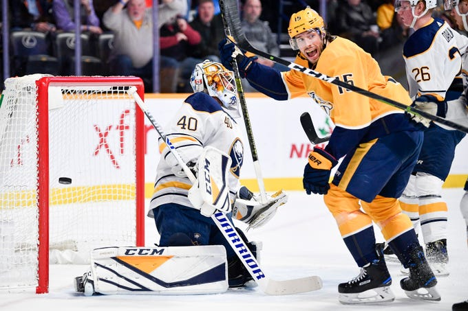 Nashville Predators right wing Craig Smith (15) reacts to a goal scored by defenseman Ryan Ellis past Buffalo Sabres goaltender Carter Hutton (40) during the first period at Bridgestone Arena in Nashville, Tenn., Monday, Dec. 3, 2018.