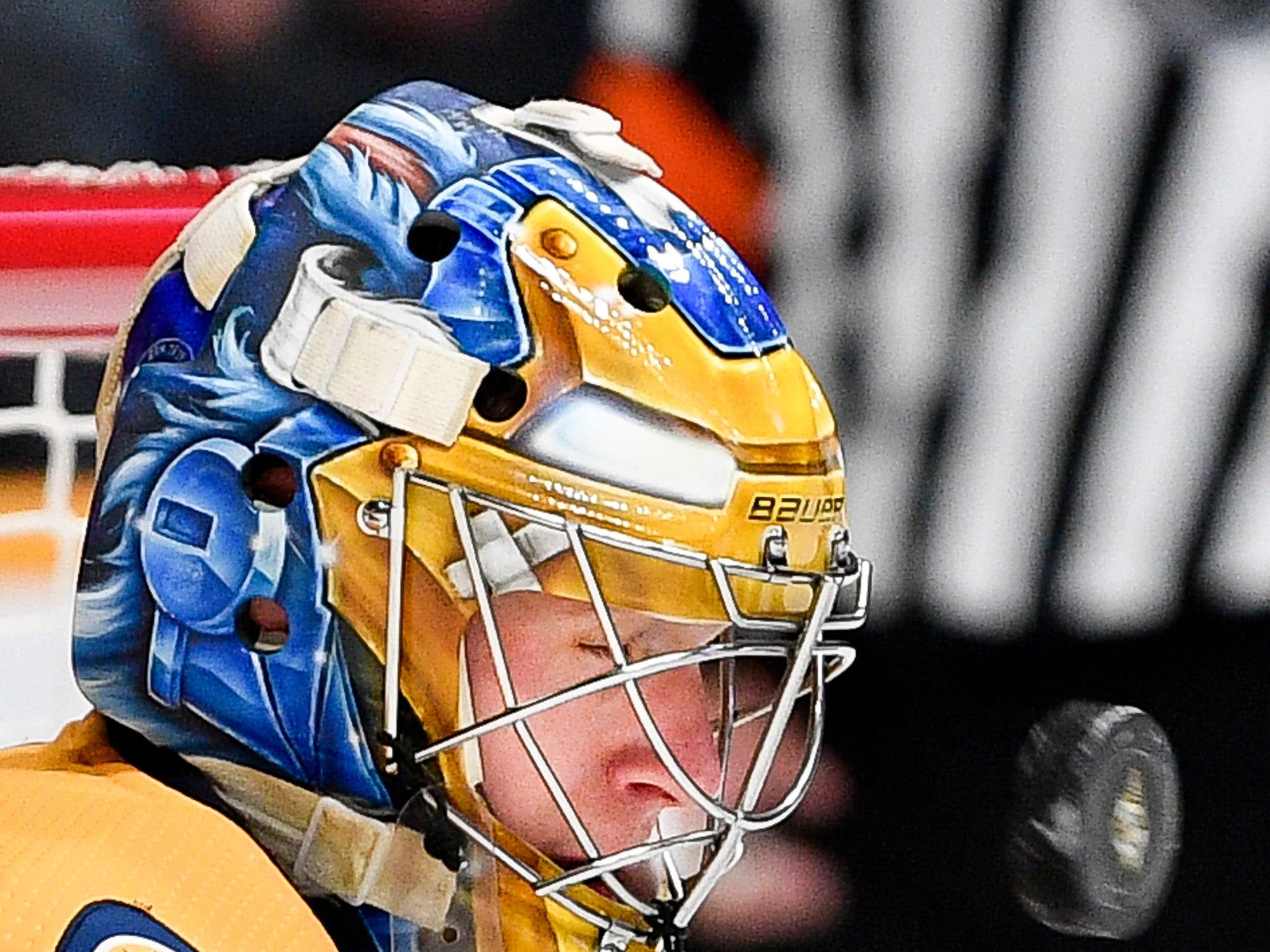 Nashville Predators goaltender Pekka Rinne (35) blocks a Buffalo Sabres shot during the second period at Bridgestone Arena in Nashville, Tenn., Monday, Dec. 3, 2018.