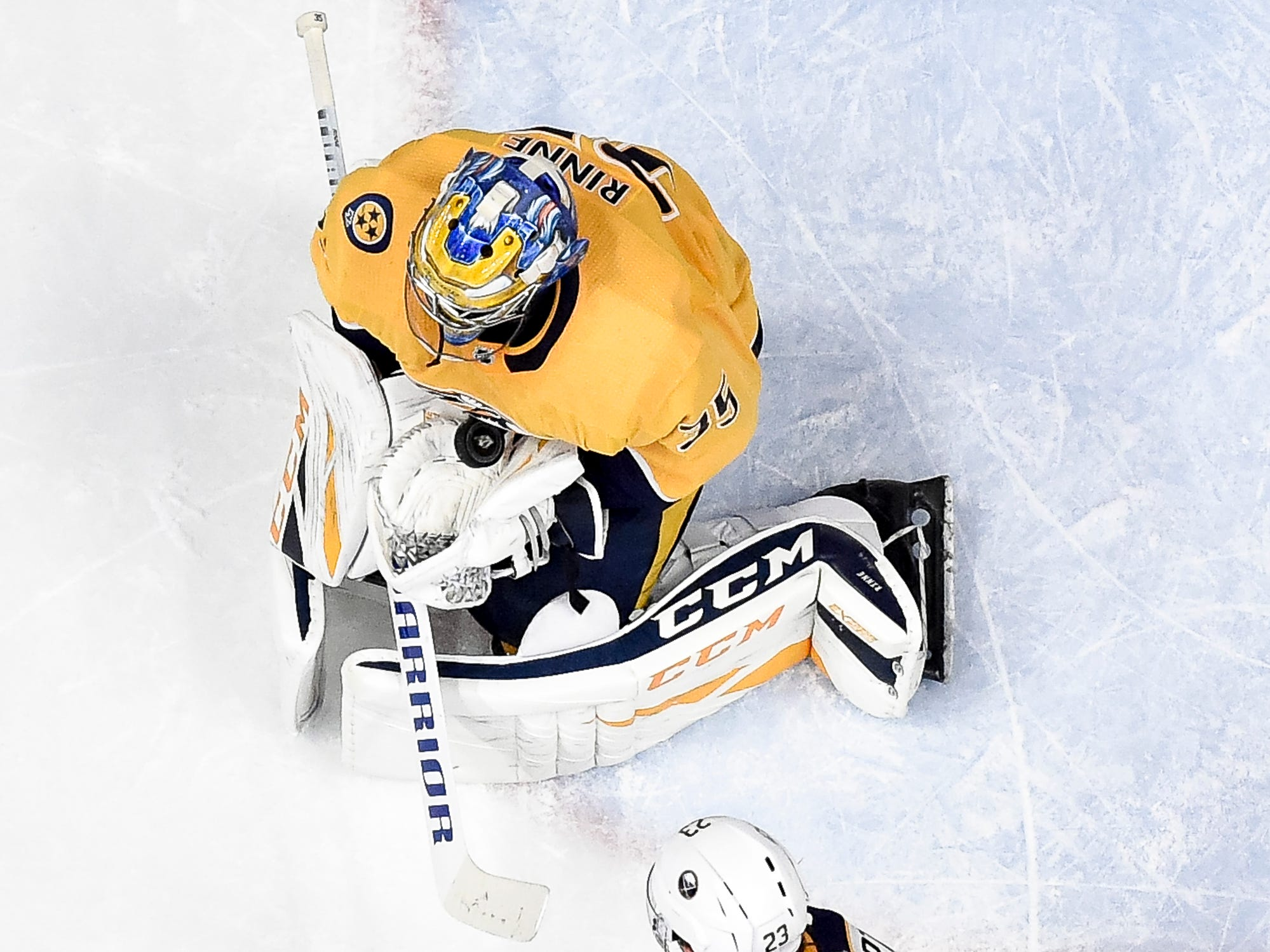 Nashville Predators goaltender Pekka Rinne (35) makes a save next to Buffalo Sabres center Sam Reinhart (23) during the third period at Bridgestone Arena in Nashville, Tenn., Monday, Dec. 3, 2018.