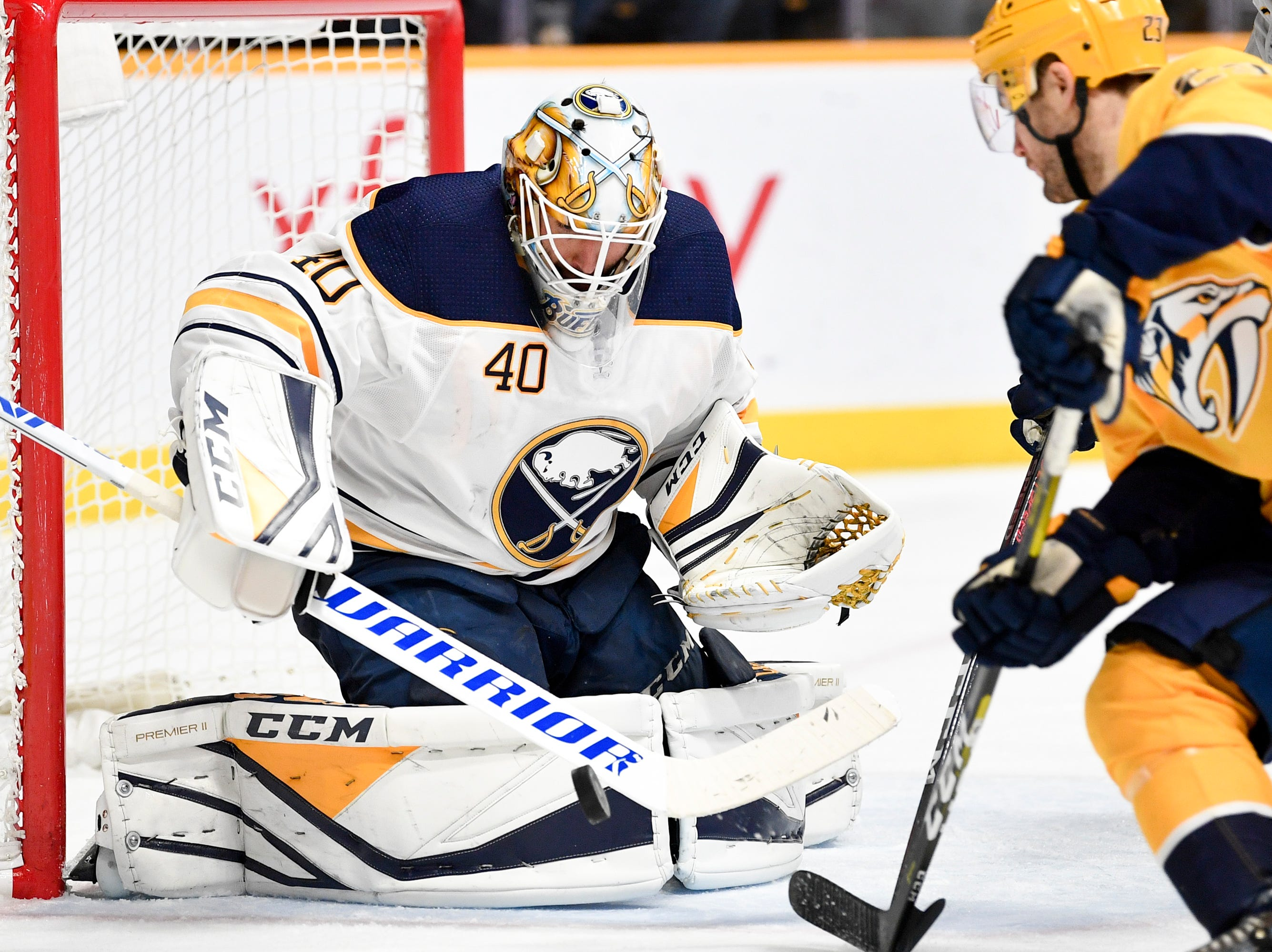 Buffalo Sabres goaltender Carter Hutton (40) defends against Nashville Predators center Rocco Grimaldi (23) during the third period at Bridgestone Arena in Nashville, Tenn., Monday, Dec. 3, 2018.