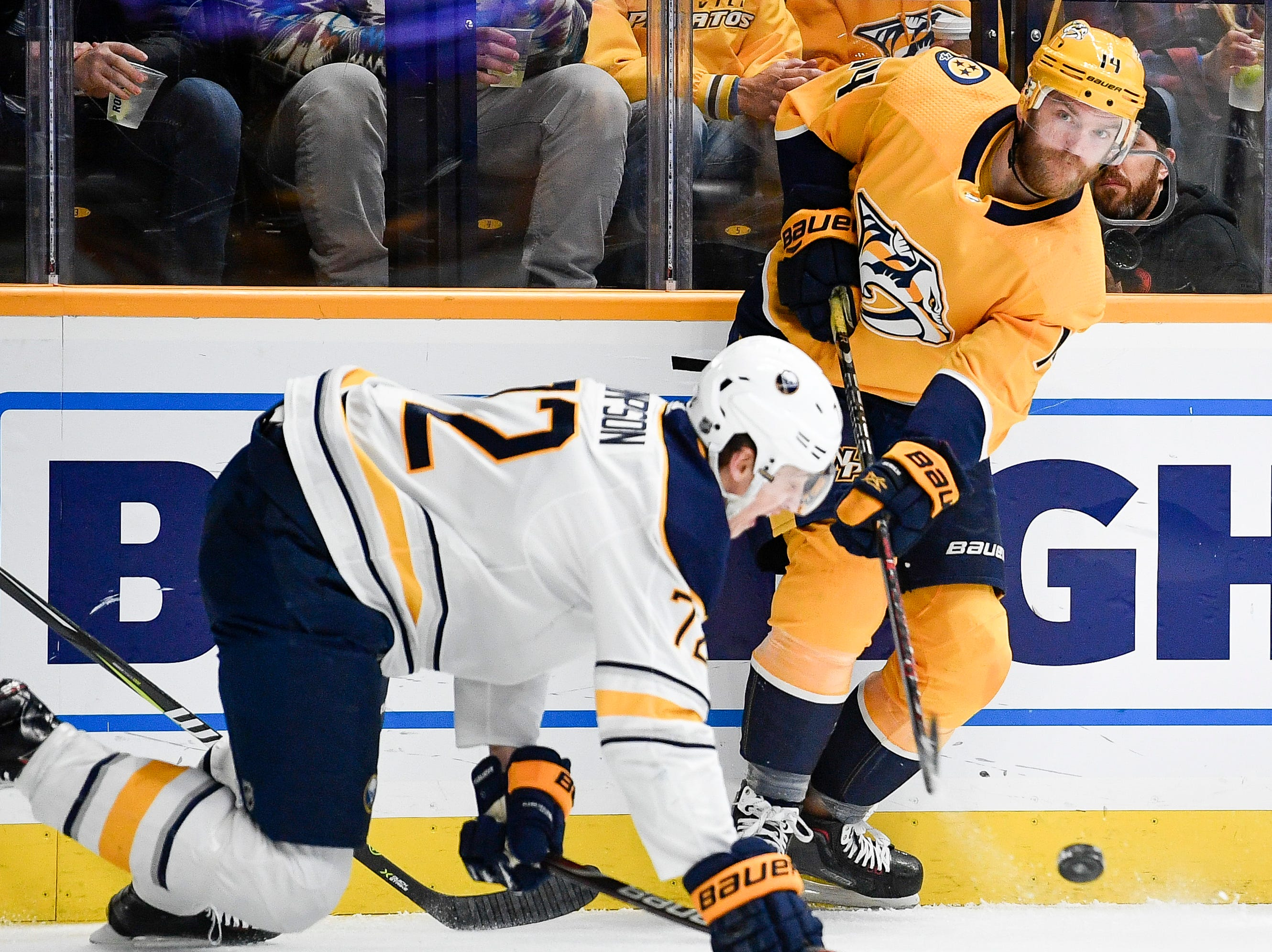Nashville Predators defenseman Mattias Ekholm (14) passes past Buffalo Sabres right wing Tage Thompson (72) during the first period at Bridgestone Arena in Nashville, Tenn., Monday, Dec. 3, 2018.