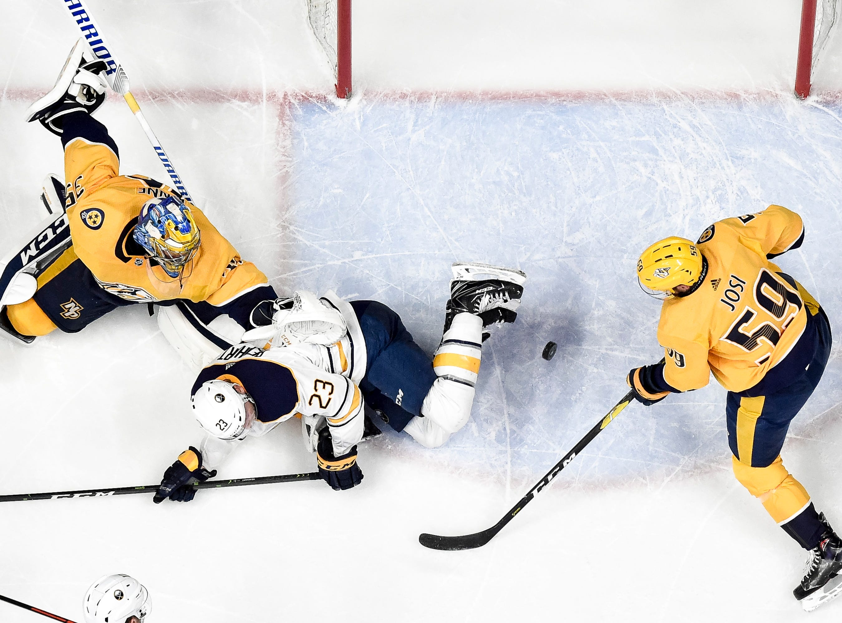 Nashville Predators goaltender Pekka Rinne (35) and defenseman Roman Josi (59) defend against Buffalo Sabres center Sam Reinhart (23) during the third period at Bridgestone Arena in Nashville, Tenn., Monday, Dec. 3, 2018.