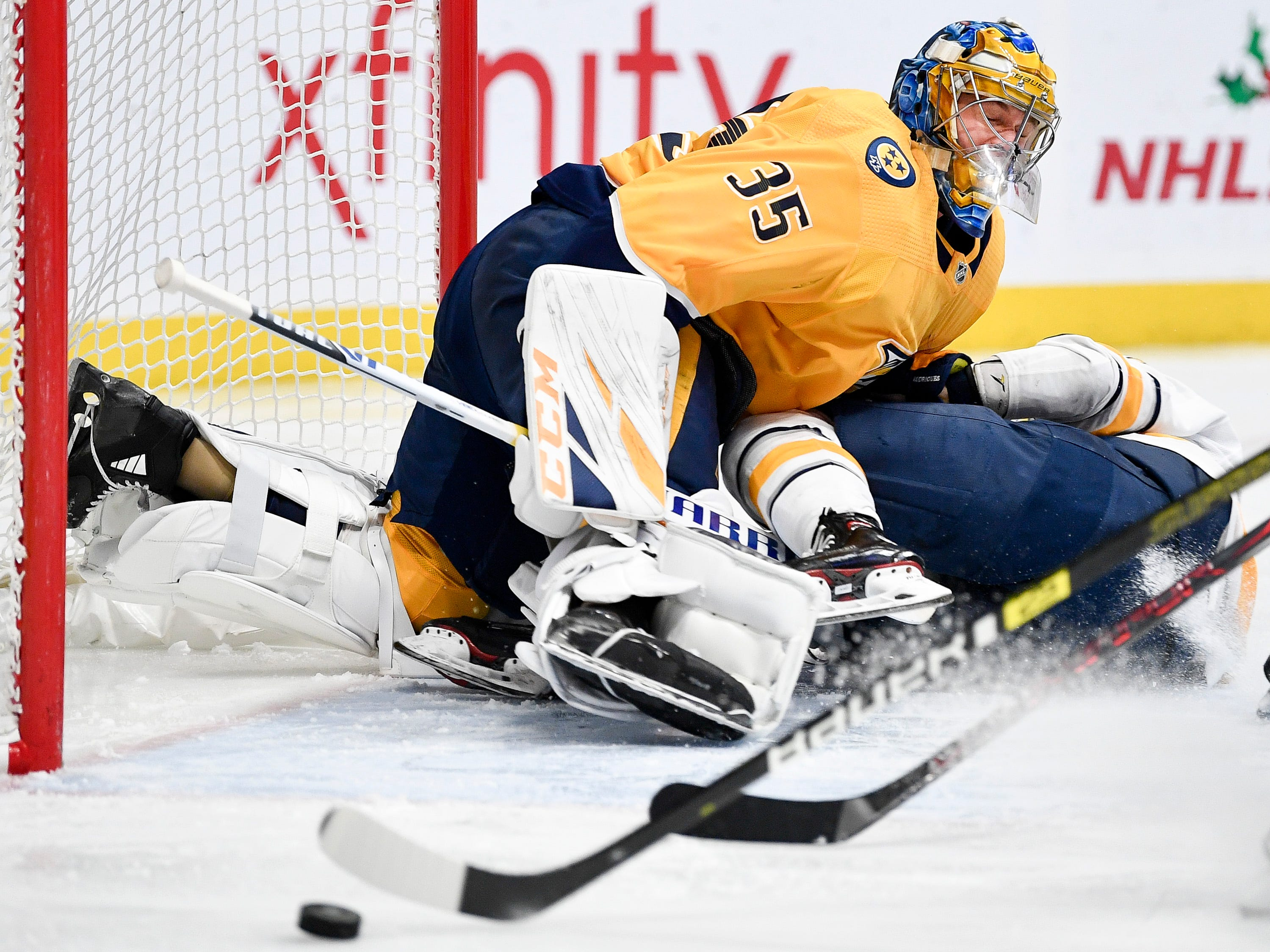 Nashville Predators goaltender Pekka Rinne (35) collides with Buffalo Sabres left wing Evan Rodrigues (71) during the second period at Bridgestone Arena in Nashville, Tenn., Monday, Dec. 3, 2018.