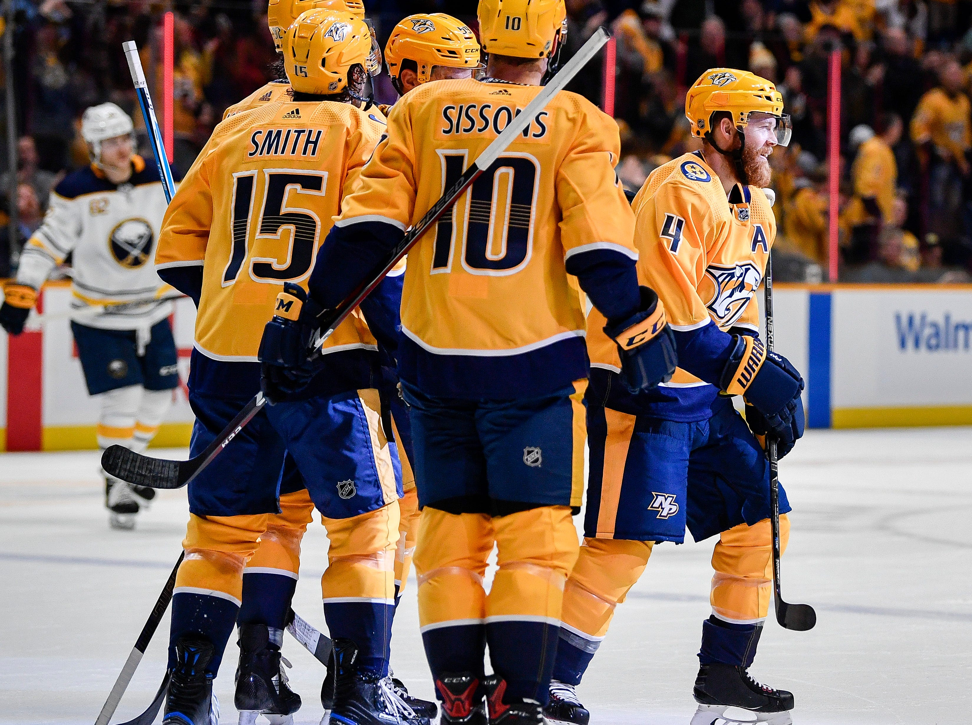 Nashville Predators defenseman Ryan Ellis (4) reacts to scoring a goal against the Buffalo Sabres during the first period at Bridgestone Arena in Nashville, Tenn., Monday, Dec. 3, 2018.