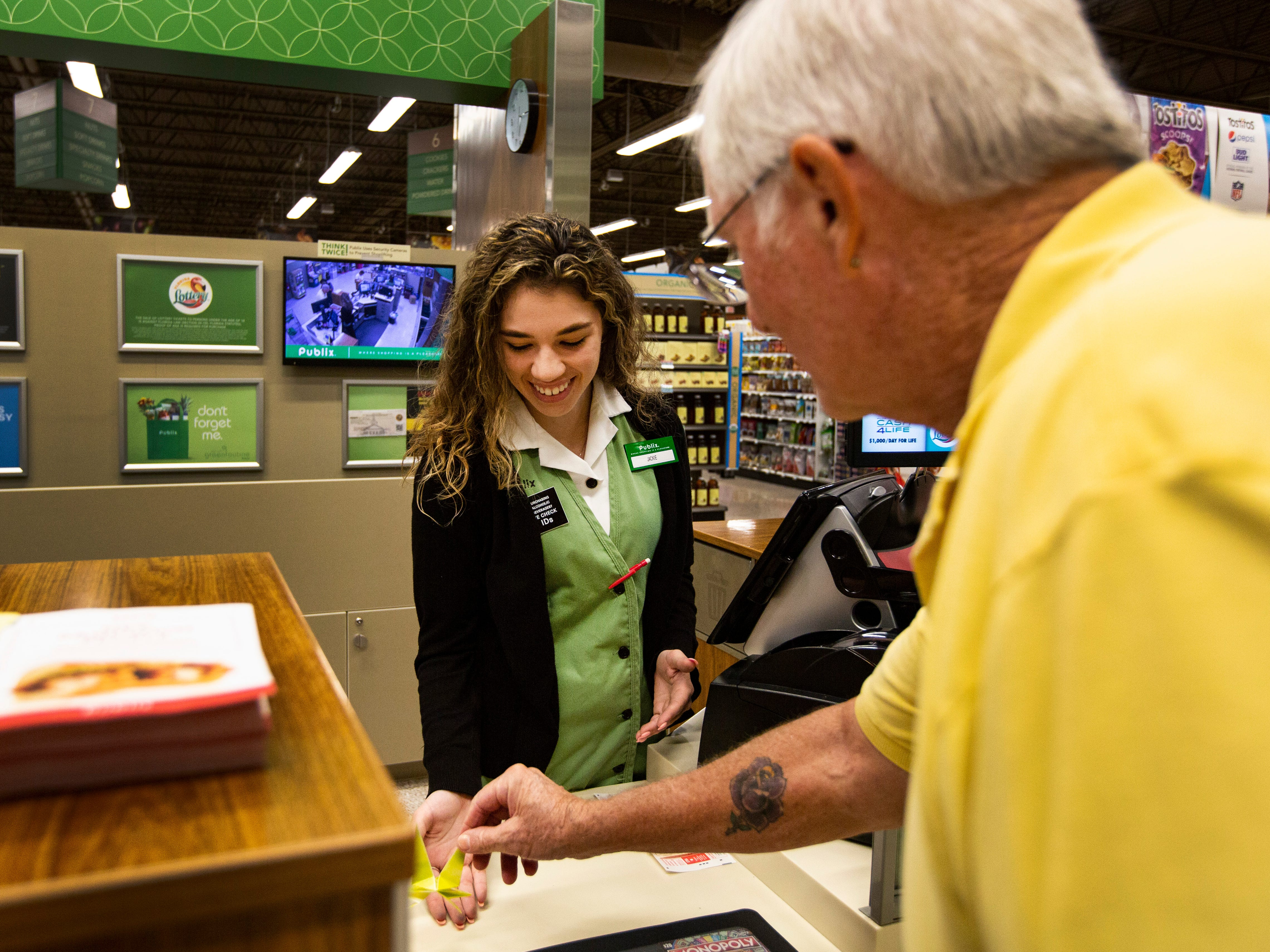 """Hi, how are you? Have I given you one of these?,"" said Dave to Jackie Haney, Thursday afternoon, Nov. 1, 2018, at a Publix supermarket, while placing a slightly big paper rabbit on Haney's hand. 