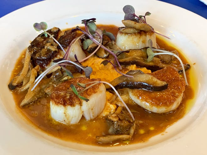 Pan-seared scallops with sweet potato puree, seasonal mushrooms and roast chicken jus is an entree on a special throwback edition menu in December for Campiello, celebrating its 20th year in Naples.