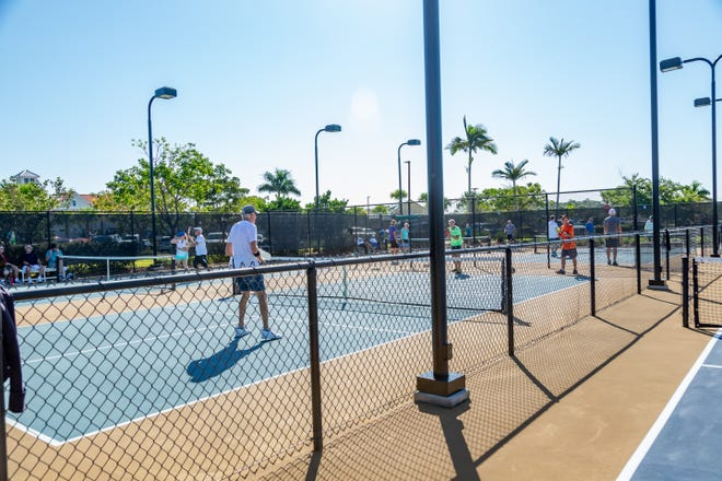 Residents of The Isles of Collier Preserve enjoy the community's four additional pickleball courts. The community now has eight courts to accommodate players.