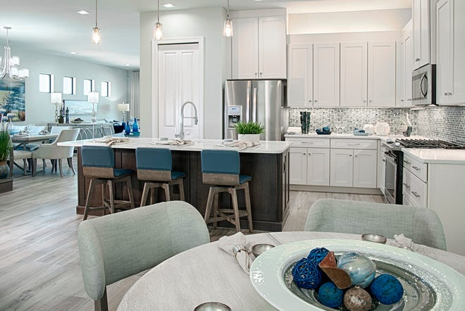 The Dolce model is one of four furnished models and seven inventory homes open daily at Venetian Pointe.