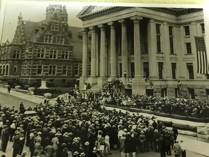 A large crowd gathered at the Passaic County Courthouse on June 25, 1927 for the dedication of the William Hughes monument.