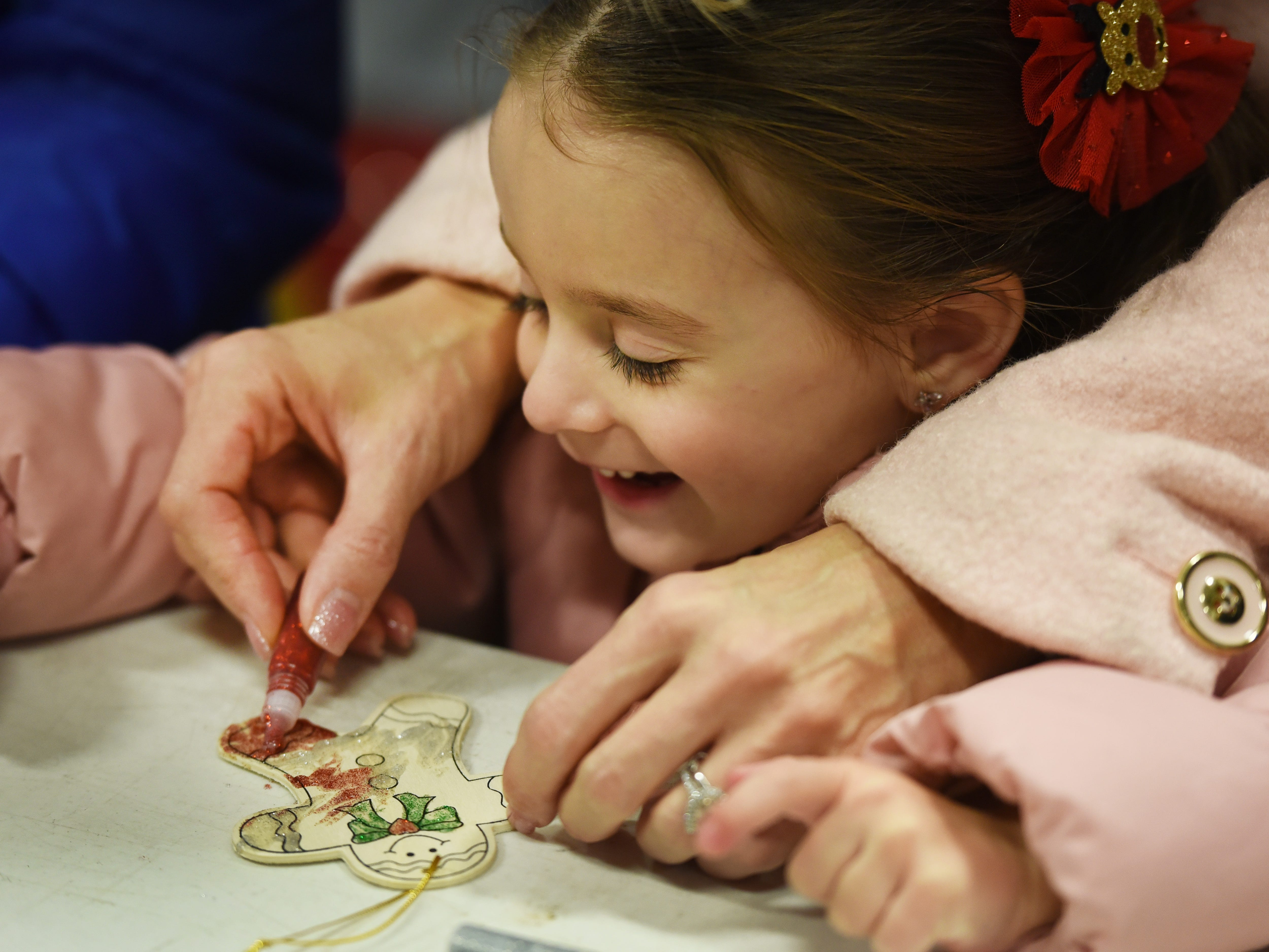 Jianna Lacapra (age 3) decorates an ornament helped by her mother Jodi prior to the Christmas Tree Lighting ceremony at Cedar Grove Town Hall on 12/03/18.