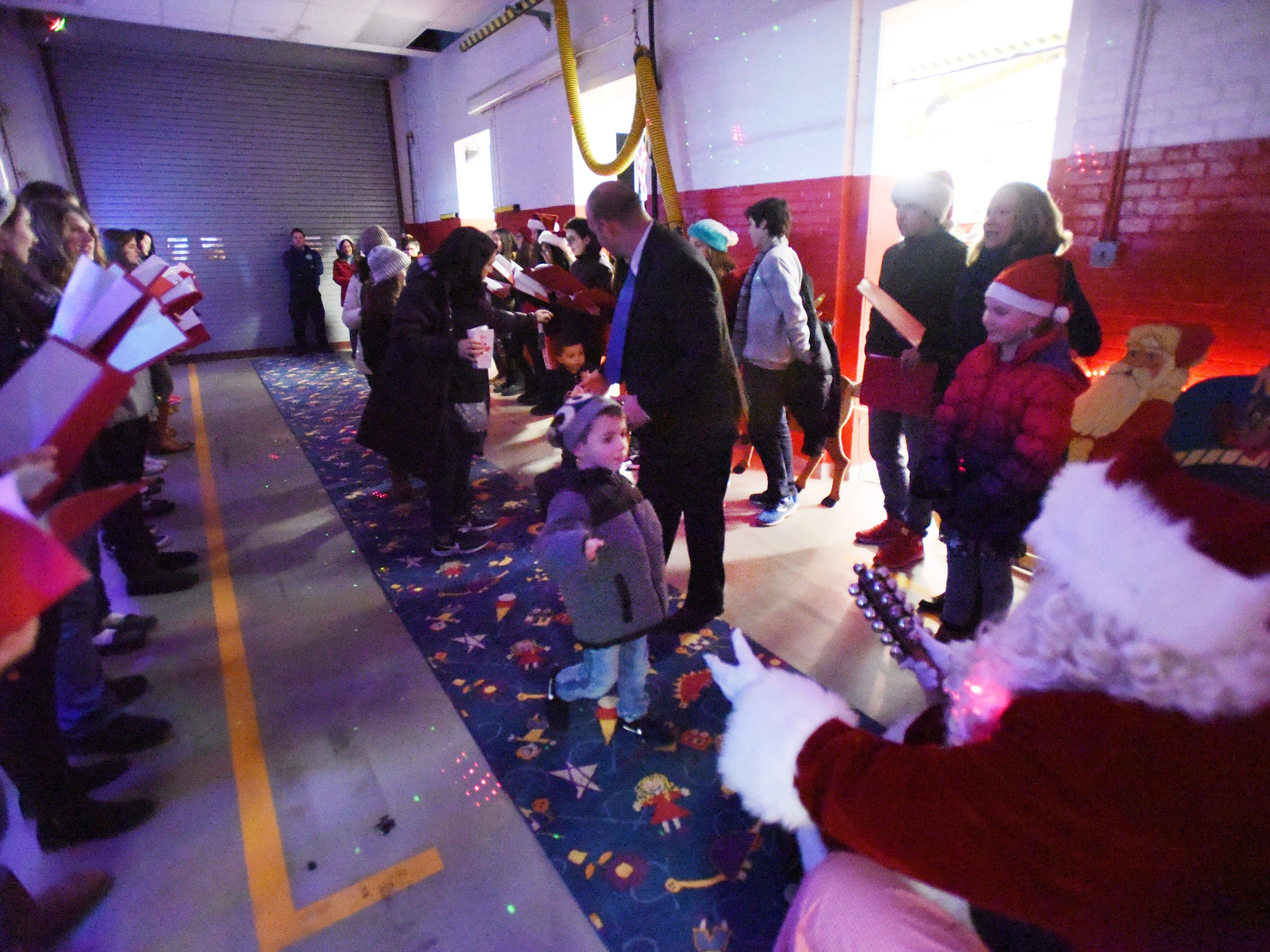 Preston Vargo (age 5) runs into the arms of Santa following the Christmas Tree Lighting ceremony at Cedar Grove Town Hall on 12/03/18.