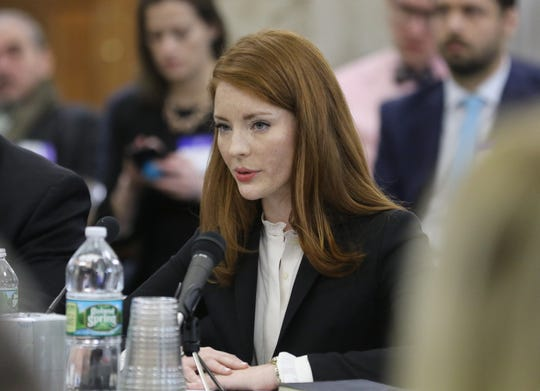 Katie Brennan, the woman who accused a former Murphy staffer of rape, testifies in front of the Select Oversight Committee in Trenton on December 4, 2018.