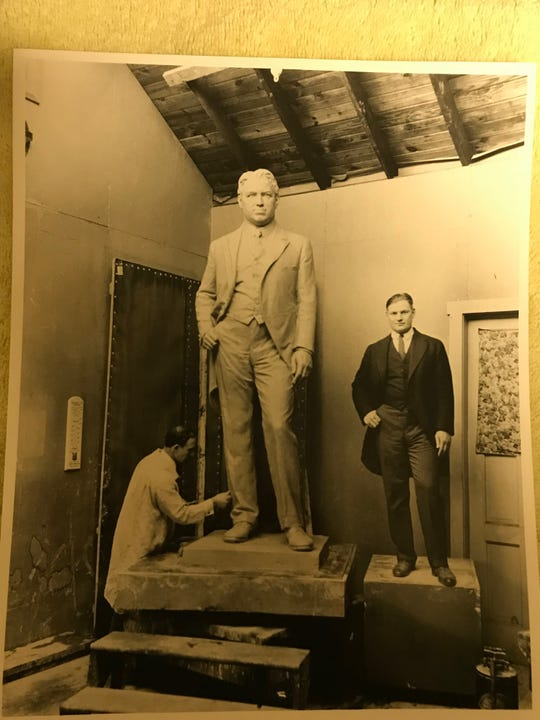 The artist Gaetano Federici in his studio working on the William Hughes sculpture. At right is a model standing in for William Hughes.