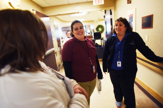 Project SEARCH intern Maria Bastista (age 20) of Teaneck, chats with Kelly Radburn (foreground), Clinical Co-ordinator, and Maria Ekiert (R), Unit Secretary, at the nursing unit of Holy Name Medical Center in Teaneck on 12/04/18.