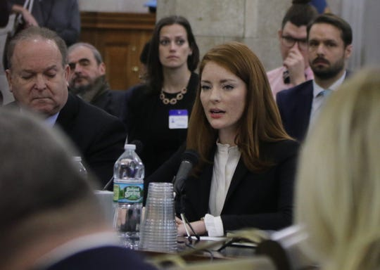 Katie Brennan, the woman who accused a former Murphy staffer of rape, testifies in front of the Senate Oversight Committee in Trenton on December 4, 2018.