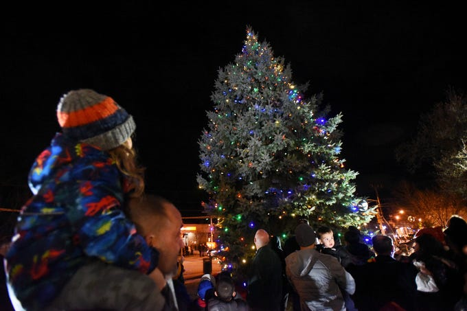 Mason Straile (age 5) watches as he sits on the shoulders of his father Joey as the Christmas Tree is lit at Cedar Grove Town Hall on 12/03/18.