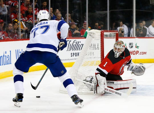 Tampa Bay Lightning defenseman Victor Hedman (77) plays the puck against New Jersey Devils goaltender Keith Kinkaid (1) during first period at Prudential Center.