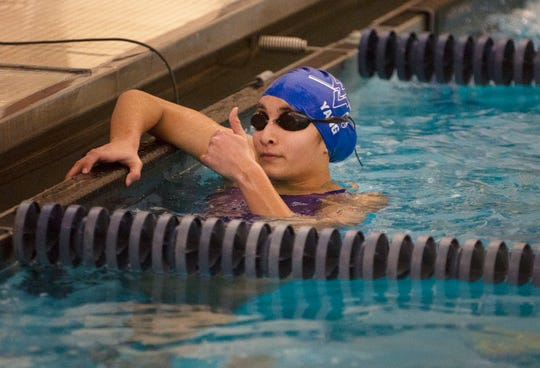 Grace Sendak of Wayne Valley celebrates her win in the 500 yard freestyle during the boys and girls swimming meet between Northern Highlands and Wayne Valley at the Wayne YMCA in Wayne on 12/04/18.
