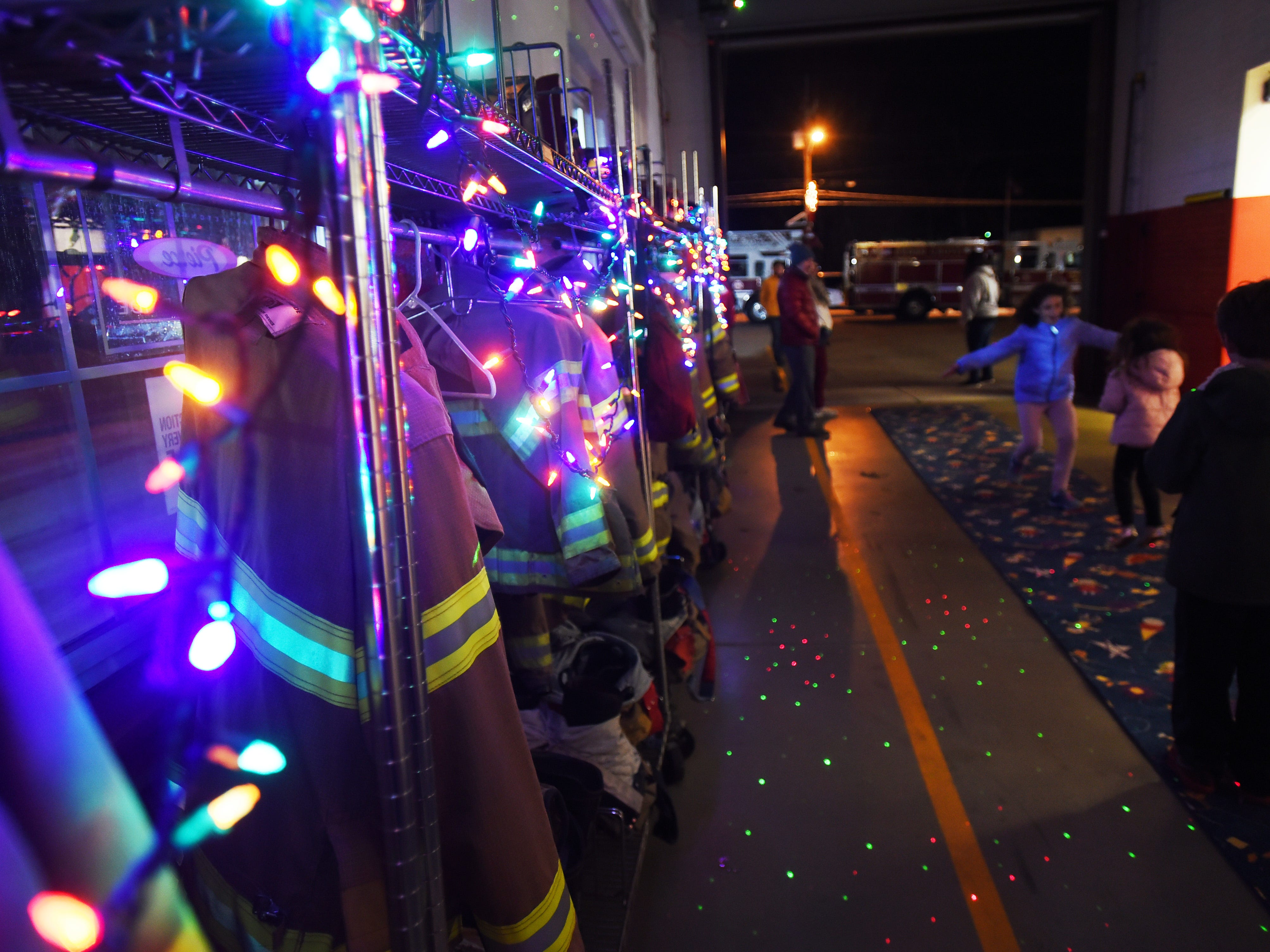 Christmas lights illuminate firefighters jackets inside of Center Fire Company 1, prior to the Christmas Tree Lighting ceremony at Cedar Grove Town Hall on 12/03/18.