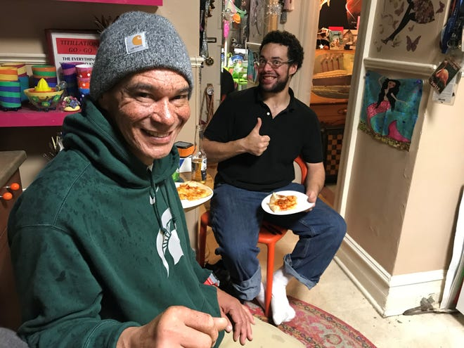 "Fred Duff and Lawrence ""Junior"" Penn eat pizza in the home of Melissa DiMarco."