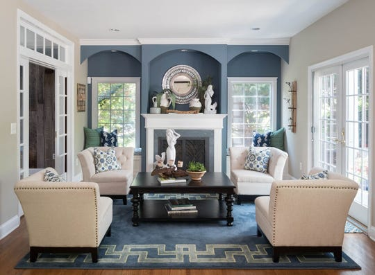 Nicole Rice of Coastal Decor & Interior Design in Fair Haven wanted to make this room a conversational area with the fireplace as the focal point in this Atlantic Highlands home.