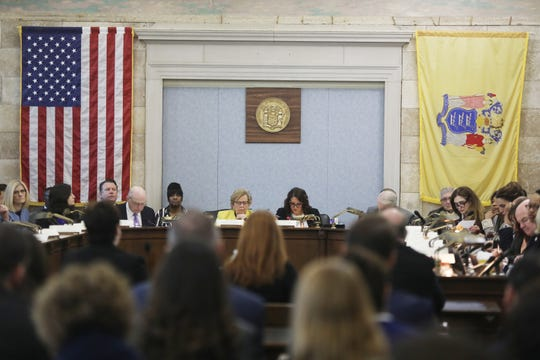 Katie Brennan, facing Select Oversight Committee Chairwoman Sen. Loretta Weinberg and Co-Chairwoman Assemblywoman Eliana Pintor Marin, testifies about her charge that she was raped by a staffer for Gov. Phil Murphy. She is in front of the committee in Trenton on December 4, 2018.