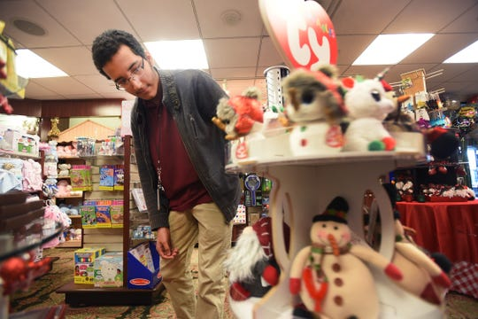 Project SEARCH intern Kenneth Machorro (age 20) of Englewood, sorts out soft toys at the gift shop located at the main lobby of Holy Name Medical Center in Teaneck on 12/04/18.