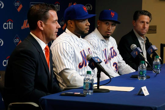 New York Mets General Manger Brodie Van Wagenen, left, New York Mets Robinson Cano, second left, Edwin Díaz, third left, and team COO Jeff Wilpon participate in a news conference at CitiField, in New York, Tuesday, Dec. 4, 2018. The Mets acquired eight-time All-Star second baseman Robinson Cano and major league saves leader Edwin Diaz from the Seattle Mariners in a seven-player trade Monday.