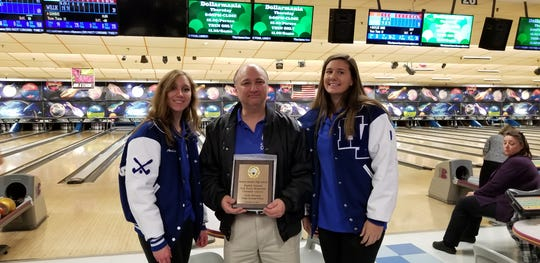 Holy Angels finished second in the girls division at the Tom Irwin Memorial Crusader Classic bowling tournament on Friday, Nov. 30, 2018. From left: Junior Amelia Brunda, coach Pat Dunne and sophomore Isabelle Egan.