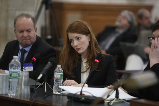 Katie Brennan, the woman who accused a former Murphy staffer of rape, listens to questions from attorney Michael Critchley as she testifies in front of the Senate Oversight Committee in Trenton on December 4, 2018.