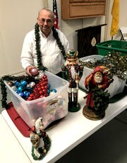Larry Utley has been busy putting the Deming-Luna-Mimbres Museum in a festive holiday setting for Sunday's Green Tea fundraiser.