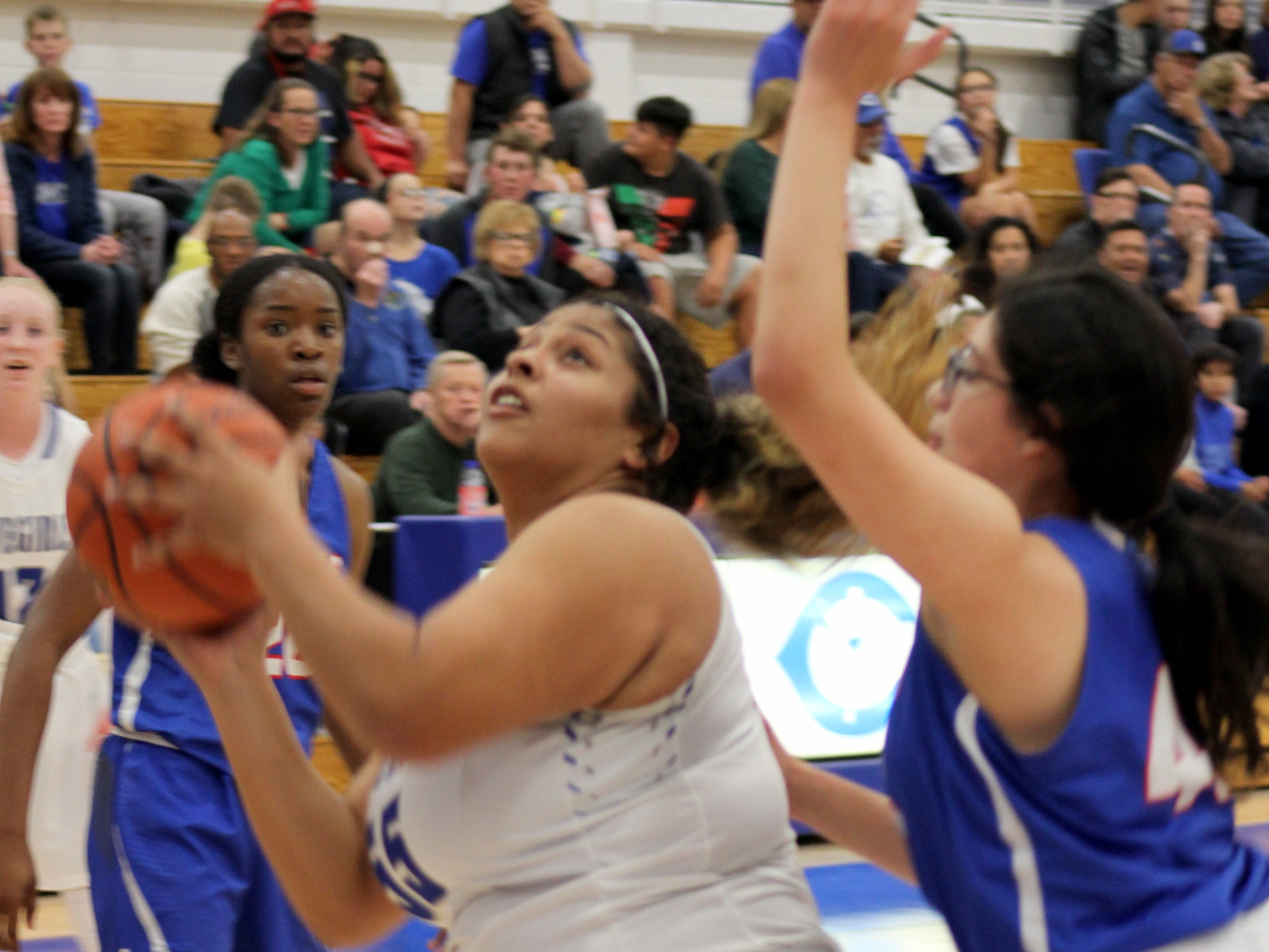 Carlsbad junior Kaliyah Montoya goes for a post shot during Monday's game against Americas. She finished with 23 points.